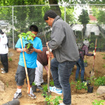 Students gather to help plant a rain garden at a grant-funded project site.